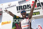 Craig Alexander raises the finish banner at the Ironman 70.3…