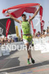 Michael Weiss celebrates his finish at the Ironman 70.3 World…