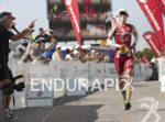 Karin Thuerig at the finish line of the Ironman 70.3…