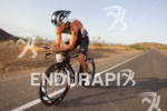 Raynard Tissink on bike competing at the Ironman World Championship…