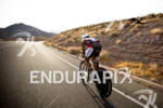 Craig Alexander (AUS) on bike competing in the Ironman World…