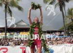 Chrissie Wellington salutes the crowd as she  celebrates her fourth…