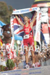 Chrissie Wellington celebrates as champion of the 2011 Ford Ironman…