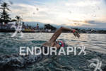 Female age group athlete swimming to the swim start of…