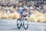 Julie Dibens (GBR) competing in the bike portion of the…