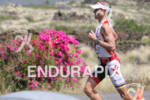 Craig Alexander competing in the run portion of the 2011…