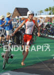 Andi Boecherer from Germany in the swim to bike transition…
