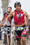 Leon GRIFFIN enters T2 at the  Ironman 70.3 California on…