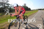 Christie Sym on bike at the Ironman Texas on May…