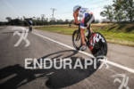 Justin Daerr on bike at the Ironman Texas on May…