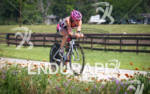 Cait Snow bikes past the Texas wild flowers at the…