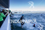 Age group athletes jump from the boat at the Escape…