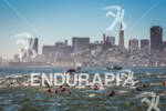 Athletes swim past the SF skyline at the 2012 Escape…