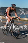 Andy Potts bikes back to transition at the 2012 Escape…