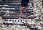 Athlete starts the run up the sand stairs at the…