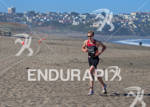 Jon Bird makes his way up the beach and to…