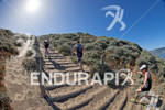 Athletes make their way up the sand stairs at the…