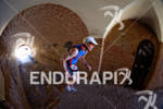 Age group athlete David Posey runs through the tunnels at…
