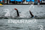 Athletes on second lap of swim at the Ironman Coeur…