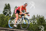 Meredith Kessler races downhill on her bike at the Ironman…