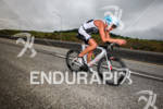 Lewis Elliot races downhill on bike at the Ironman Coeur…