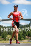 Meredith Kessler running to victory at the Ironman Coeur d'…