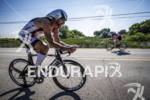 Rhodsey riding back to T2 of the Ironman 70.3 Racine,…