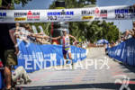 Jessica Jacobs approaching the finish line of the Ironman 70.3…