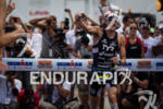 Andy Potts celebrating his decisive victory at the Ironman Lake…