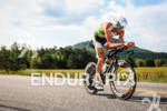 Pete Jacobs races on the bike trying to catch the…