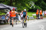 Mathew Russlle takes a perfect handoff at bike  aid station…