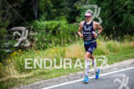 Andy Potts runs down River Road on the way to…