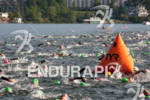 Triathletes swim at the 2012 Ironman Lake Placid Triathlon in…