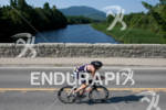 Andy Potts crosses a bridge at the 2012 Ironman Lake…