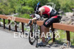 A competitor shows fatigue during the bike leg at the…
