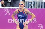 Laura BENNETT (USA) exhausted after crossing the finish line at…
