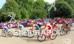 Olympic women bike in  front of spectators at the 2012…