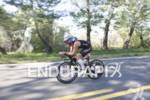 Joe Gambles maintaining a first place lead on the bike…