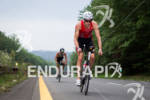 Trevor Wurtele climbs during the bike at the 2012 Ironman…