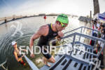 One of the fast age grouper swimmers exit the swim…