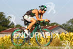 Mike Hermanson bikes past tobacco fields at the 2012 Ironman…