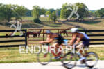 Athletes bike past the many horse farms during the 2012…