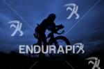 Silhouette of an athlete on the bike at the Ironman…