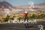 Meredith Kessler climbs the many hills on her bike at…