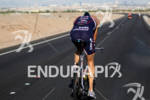 Andy Potts on bike heading into town toward T2 at…