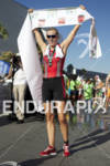 Alicia Kaye celebrates her first place women's finish at the…