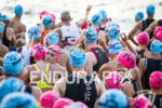 Age group athletes embrace as they prepare for the swim…