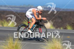 Joe Gambles bikes on the Queen K at the Ironman…