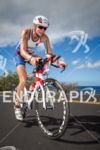 Leanda Cave climbs toward Hawi on bike at the Ironman…
