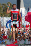 Viktor Zyemtsev crosses the finish line at the Ironman World…